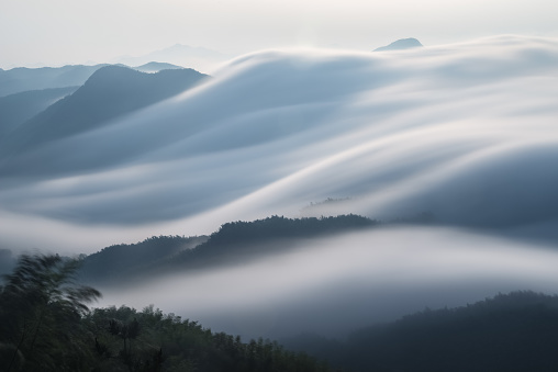 flowing clouds closeup on mountains 1028691114