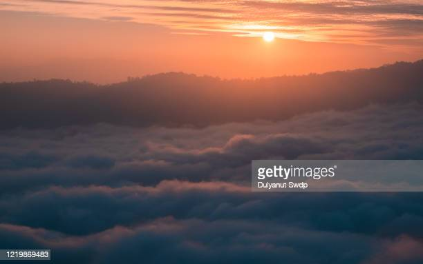 flowing clouds closeup on mountains - thick stock pictures, royalty-free photos & images