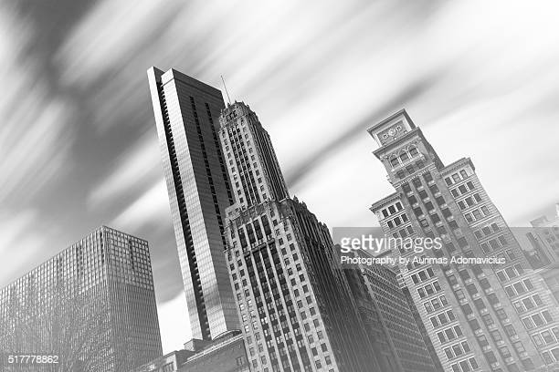 Flowing clouds through Chicago high rises in b&w