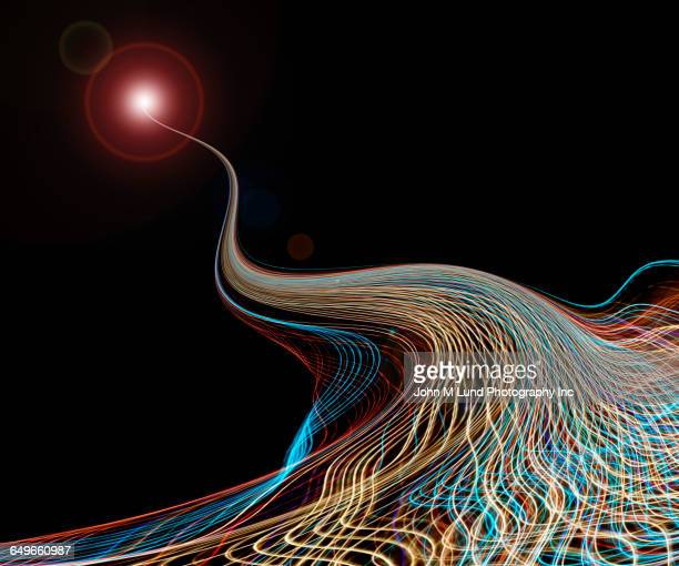 flowing multicolor light streams - john lund stock pictures, royalty-free photos & images