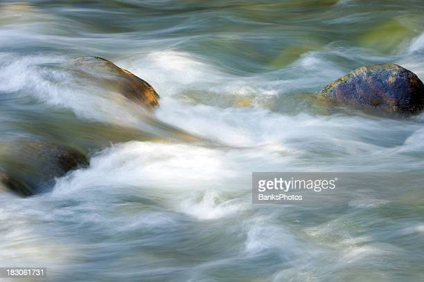 Flowing River Water Over Rocks