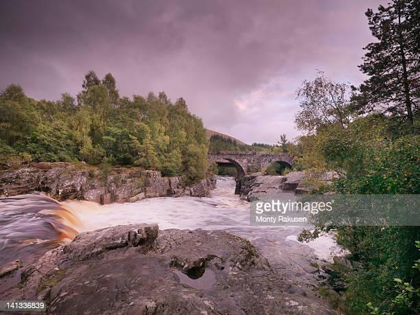 Flowing Scottish river and landscape