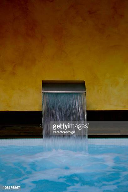 flowing spa faucet - building feature stock pictures, royalty-free photos & images