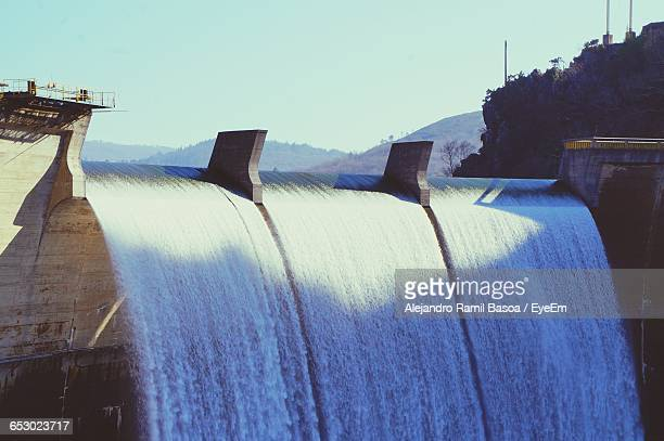 flowing water at dam - hydroelectric power station stock photos and pictures