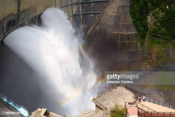 flowing water of kurobe dam in toyama prefecture, rainbow appeared, japan travel, jr route. - 富山県 ストックフォトと画像