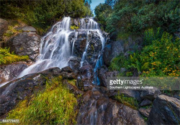 Flowing water over Falls Creek waterfall in the Alpine mountainous region of north east Victoria, Australia.