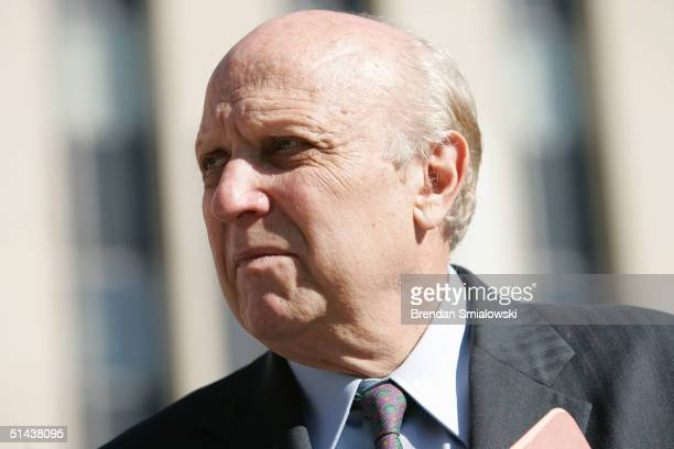 Floyd Abrams a First Amendment expert waits for his client New York Times reporter Judith Miller in front of the E Barrett Prettyman US District...