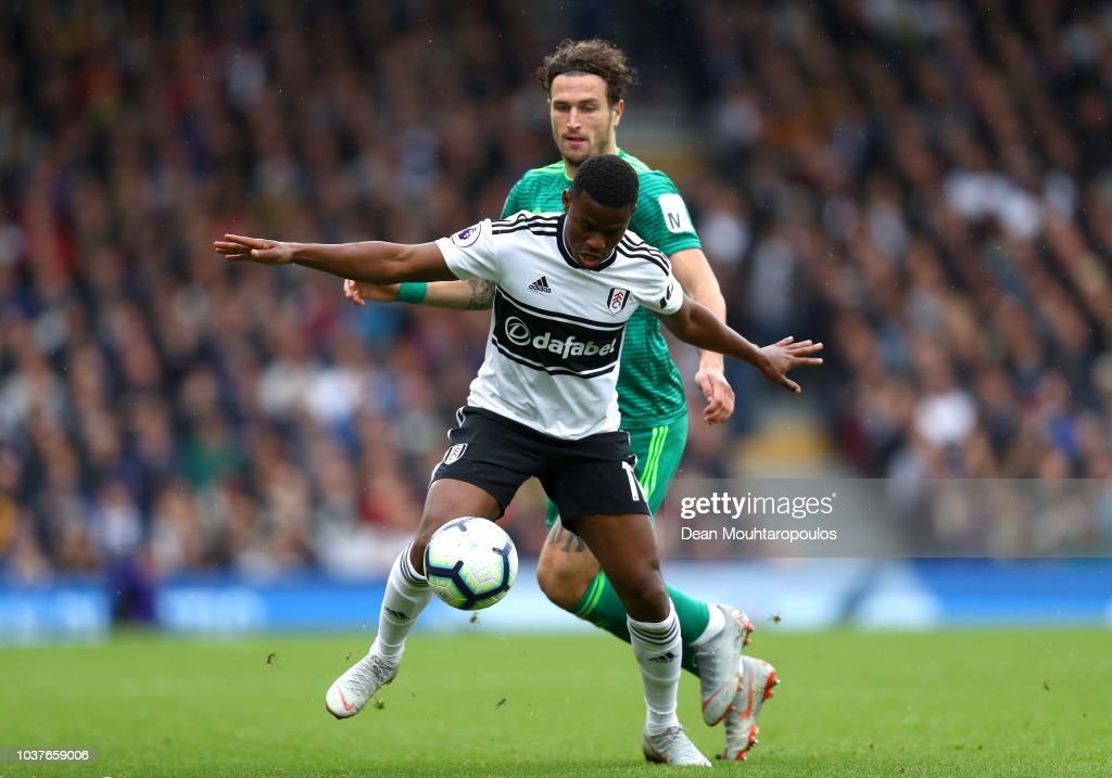 Floyd Ayite Of Fulham And Daryl Janmaat Of Watford In