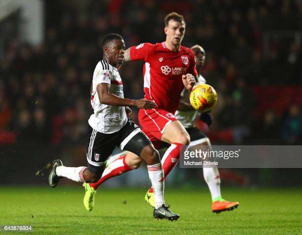 Floyd Ayite of Fulham battles with Aden Flint of Bristol City during the Sky Bet Championship match between Bristol City and Fulham at Ashton Gate on...