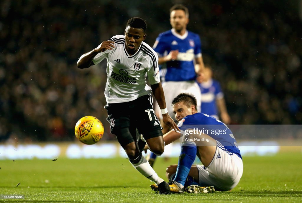 Floyd Ayite of Fulham goes past Jonas Knudsen of Ipswich during the Sky Bet Championship match between Fulham and Ipswich Town at Craven Cottage on January 2, 2018 in London, England.