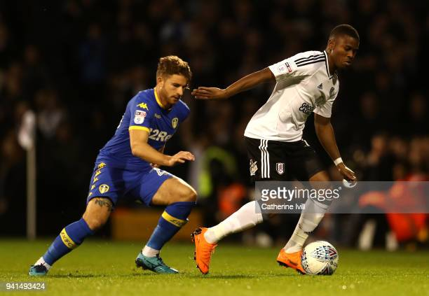 Floyd Ayite of Fulham is challenged by Gaetano Berardi of Leeds United during the Sky Bet Championship match between Fulham and Leeds United at...