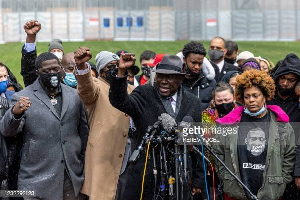 Floyd family lawyer, Ben Crump ; Philonise Floyd , brother of George Floyd; Brandon Williams , nephew of George Floyd raise their fist during press...