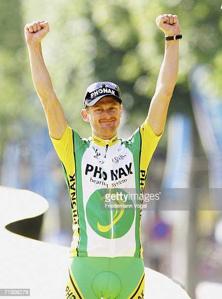 Floyd Landis of the USA and Phonak celebrates on the podium of last and Stage 20 of the 93rd Tour de France between Antony-Parc de Sceaux and Paris...