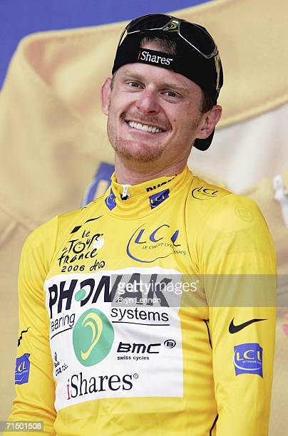 Floyd Landis of the USA and Phonak celebrates taking the yellow jersey on the penultimate stage of the 93rd Tour de France, an individual time trial...