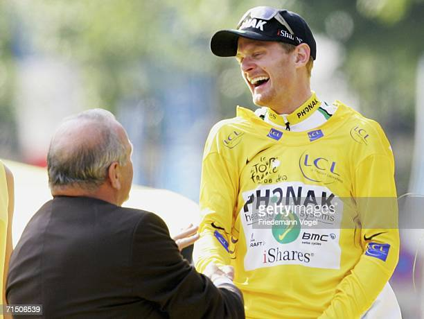 Floyd Landis of the USA and Phonak is congratulated by outgoing Tour de France director Jean-Marie Leblanc as he celebrates his yellow jersey as...