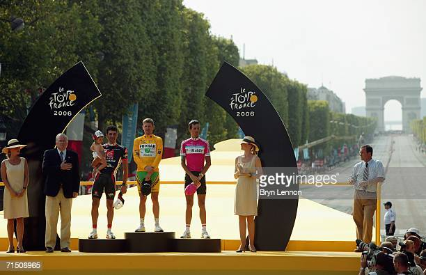 Floyd Landis of the USA and Phonak , Oscar Pereiro of Spain and Caisse d'Epargne and Andreas Kloden of Germany and T-Mobile stand on the podium after...