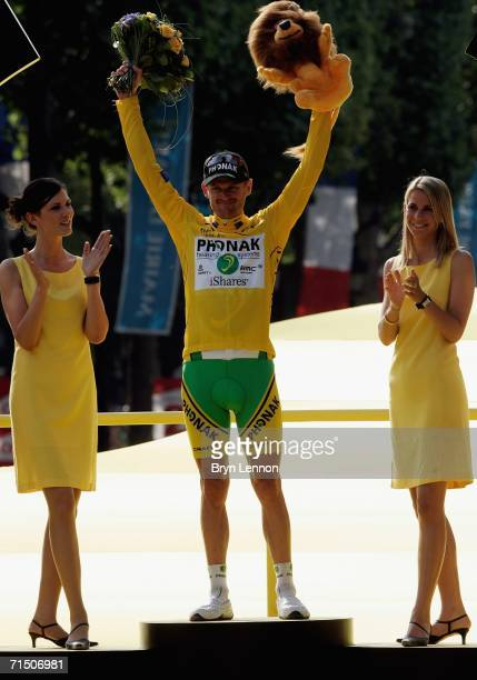 Floyd Landis of the USA and Phonak stands on the podium and celebrates winning the 93rd Tour de France, on July 23 2006 in Paris, France.