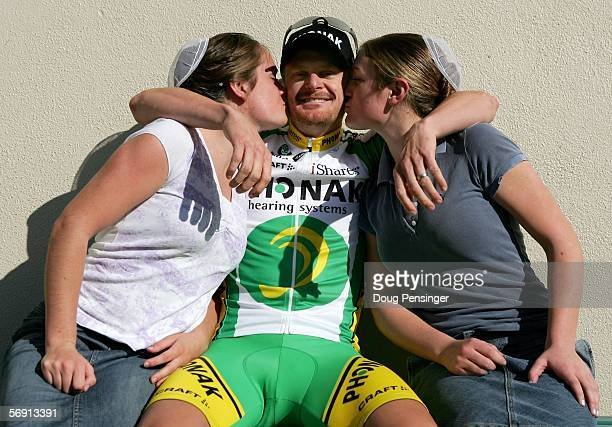 Floyd Landis of the USA, riding for Phonak, gets a kiss as he poses for a photo with his sisters, Priscilla Landis and Abigail Landis, both of...