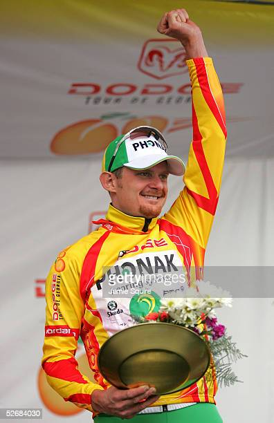 Floyd Landis of USA, riding for Team Phonak Hearing Systems, waves to the crowd as he is presented with the yellow jersey as the overall leader after...