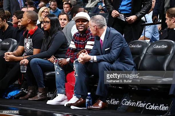 Floyd Mayweather and Brett Yormark during the Brooklyn Nets against the Phoenix Suns game on December 1 2015 at Barclays Center in Brooklyn New York...