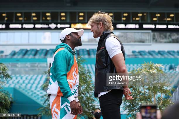 Floyd Mayweather and Logan Paul face off during media availability prior to their June 6 match at Hard Rock Stadium on May 06, 2021 in Miami Gardens,...
