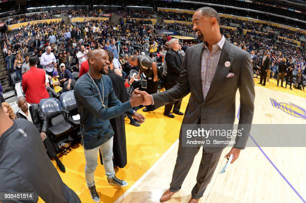 Floyd Mayweather exchanges a handshake with Juwan Howard of the Miami Heat during the game against the Los Angeles Lakers on March 16 2018 at STAPLES...
