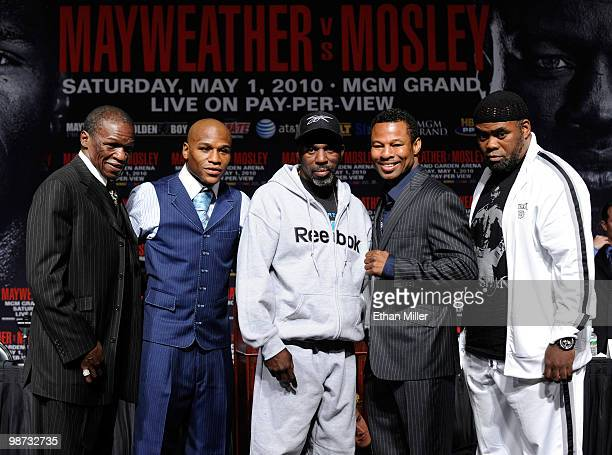 Floyd Mayweather his son boxer Floyd Mayweather Jr his trainer and uncle Roger Mayweather boxer Shane Mosley and his trainer Naazim Richardson pose...
