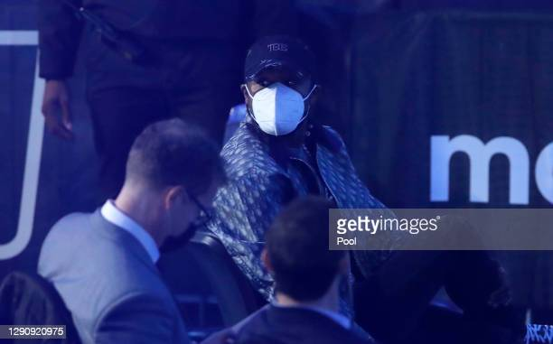 Floyd Mayweather is seen wearing a face mask as he looks on prior to the IBF, WBA, WBO and IBO World Heayweight Title fight between Anthony Joshua...