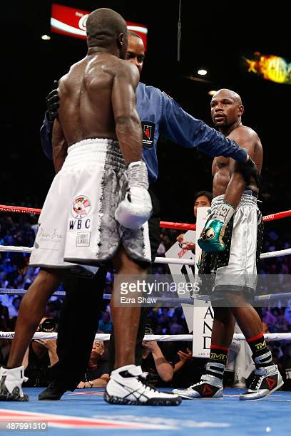 Floyd Mayweather Jr and Andre Berto stare each other down at the end of the round during their WBC/WBA welterweight title fight at MGM Grand Garden...
