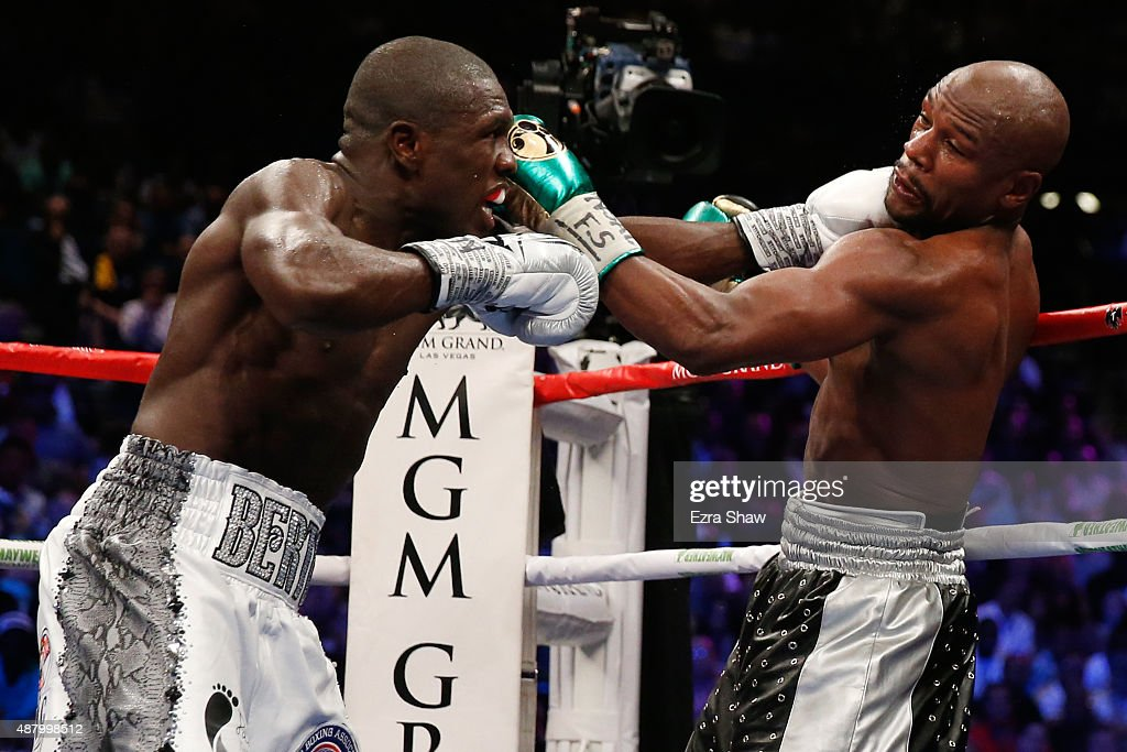 Floyd Mayweather Jr. and Andre Berto trade punches during their WBC/WBA welterweight title fight at MGM Grand Garden Arena on September 12, 2015 in Las Vegas, Nevada.