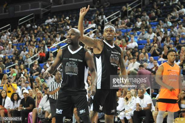 Floyd Mayweather Jr and Brandon Marshall participate in Monster Energy Outbreak $50K Charity Challenge celebrity basketball game at UCLA on July 17...