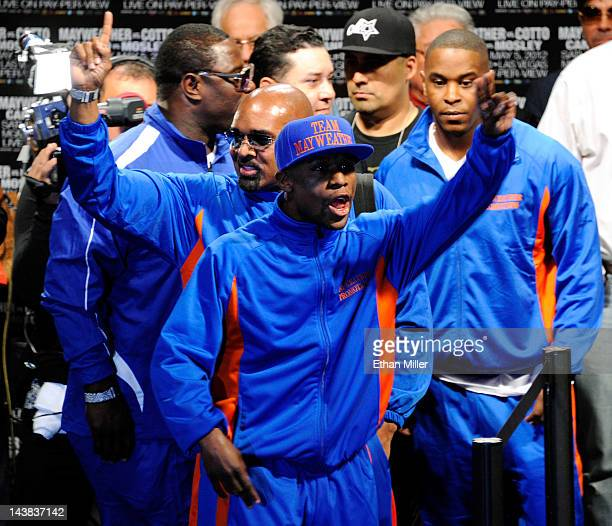 Floyd Mayweather Jr and CEO of Mayweather Promotions Leonard Ellerbe react as they arrive for the official weighin for Mayweather's bout against WBA...