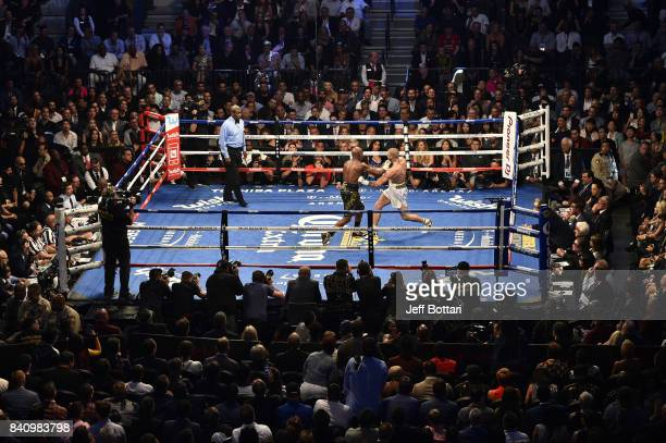 Floyd Mayweather Jr and cm exchange punches in their super welterweight boxing match at TMobile Arena on August 26 2017 in Las Vegas Nevada...