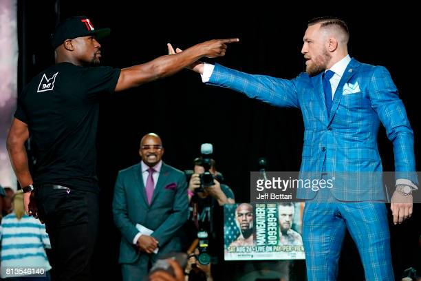 Floyd Mayweather Jr and Conor McGregor face off during the Floyd Mayweather Jr v Conor McGregor World Press Tour event at the Budweiser Stage on July...