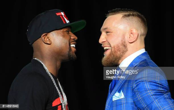 Floyd Mayweather Jr and Conor McGregor faceoff during the Floyd Mayweather Jr v Conor McGregor World Press Tour at Budweiser Stage on July 12 2017 in...