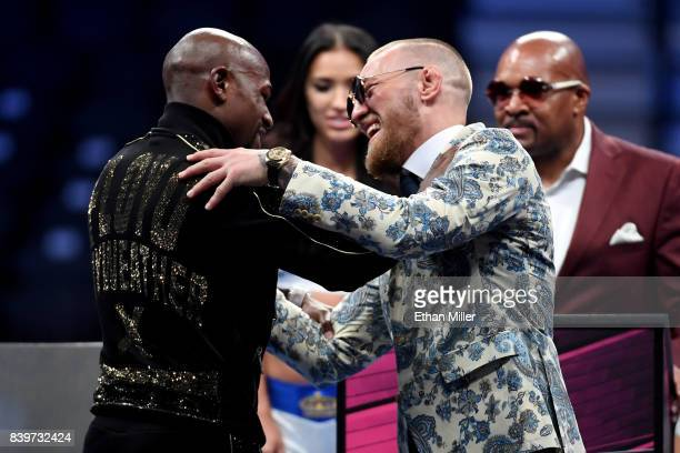 Floyd Mayweather Jr and Conor McGregor shake hands during a news confrence after Mayweather's 10thround TKO victory in their super welterweight...
