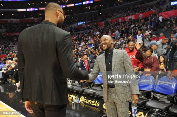 Floyd Mayweather Jr and DeMarcus Cousins attend a basketball game between the Los Angeles Clippers and the Golden State Warriors at Staples Center on...