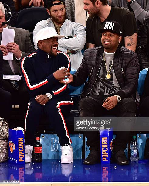 Floyd Mayweather Jr and guest attend the Minnesota Timberwolves vs New York Knicks game at Madison Square Garden on December 16 2015 in New York City