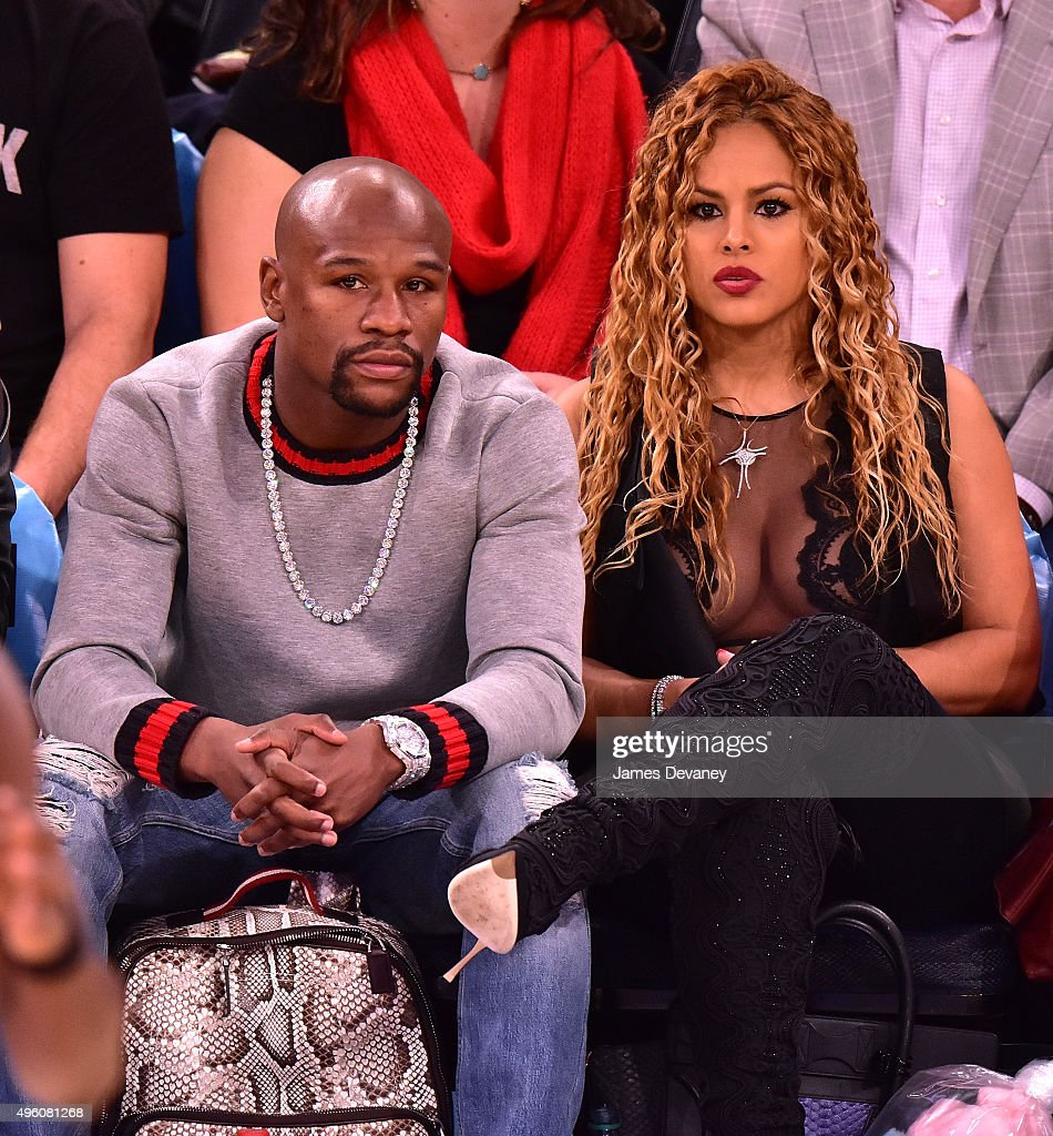 Floyd Mayweather Jr. and Liza Hernandez attend New York Knicks vs Milwaukee Bucks game at Madison Square Garden on November 6, 2015 in New York City.