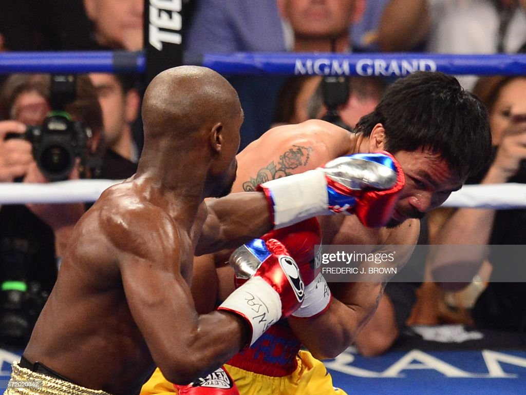 Floyd Mayweather Jr., and Manny Pacquiao (R) fight in a welterweight unification bout on May 2, 2015 at the MGM Grand Garden Arena in Las Vegas, Nevada.