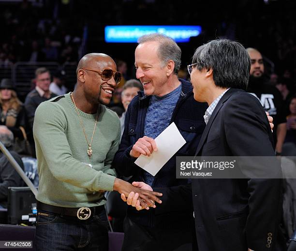 Floyd Mayweather Jr and Patrick SoonShiong attend a basketball game between the Brooklyn Nets and the Los Angeles Lakers at Staples Center on...