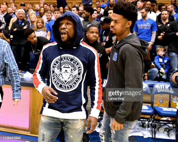 Floyd Mayweather Jr and Quinn Cook of the Golden State Warriors attend the game between the North Carolina State Wolfpack and the Duke Blue Devils at...