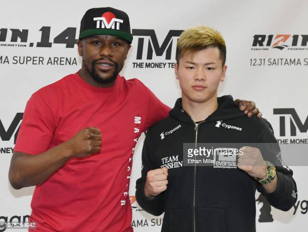 Floyd Mayweather Jr and Tenshin Nasukawa pose during a news conference at the Mayweather Boxing Club on December 6 2018 in Las Vegas Nevada The two...