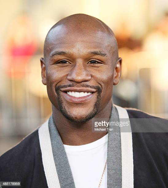 Floyd Mayweather Jr arrives at the Los Angeles premiere of 'A Haunted House 2' held at Regal Cinemas LA Live on April 16 2014 in Los Angeles...