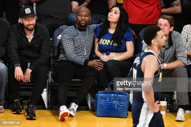 Floyd Mayweather Jr attends a basketball game between the Los Angeles Lakers and the Denver Nuggets at Staples Center on March 13 2018 in Los Angeles...