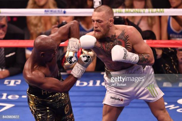 Floyd Mayweather Jr blocks a punch attempt from Conor McGregor in their super welterweight boxing match at TMobile Arena on August 26 2017 in Las...