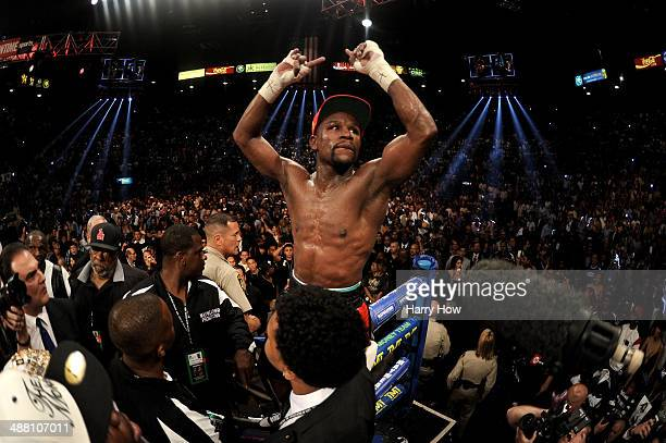 Floyd Mayweather Jr celebrates after defeating Marcos Maidana by majority decision in their WBC/WBA welterweight unification fight at the MGM Grand...