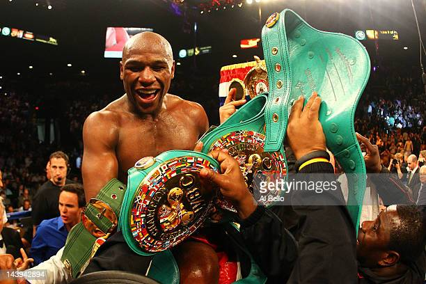 Floyd Mayweather Jr. Celebrates after defeating Miguel Cotto by unanimous decision during their WBA super welterweight title fight at the MGM Grand...