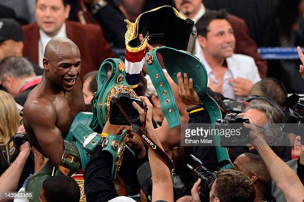 Floyd Mayweather Jr celebrates after defeating Miguel Cotto by unanimous decision during their WBA super welterweight title fight at the MGM Grand...