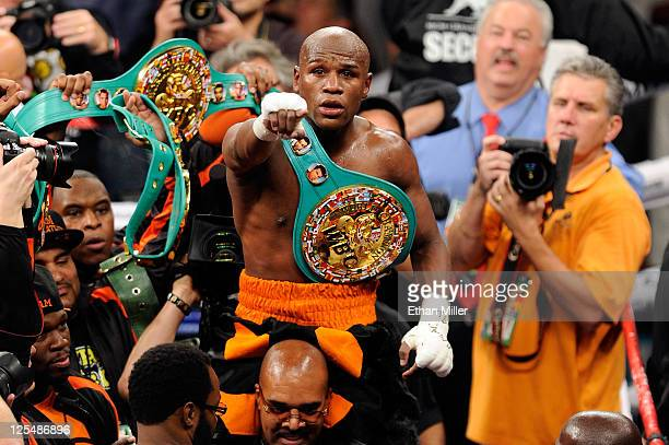 Floyd Mayweather Jr celebrates after defeating Victor Ortiz by fourth round knockout during their WBC welterweight title fight at the MGM Grand...
